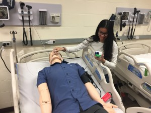 A student in our Health Occupations program practices her skills on the SimMan.